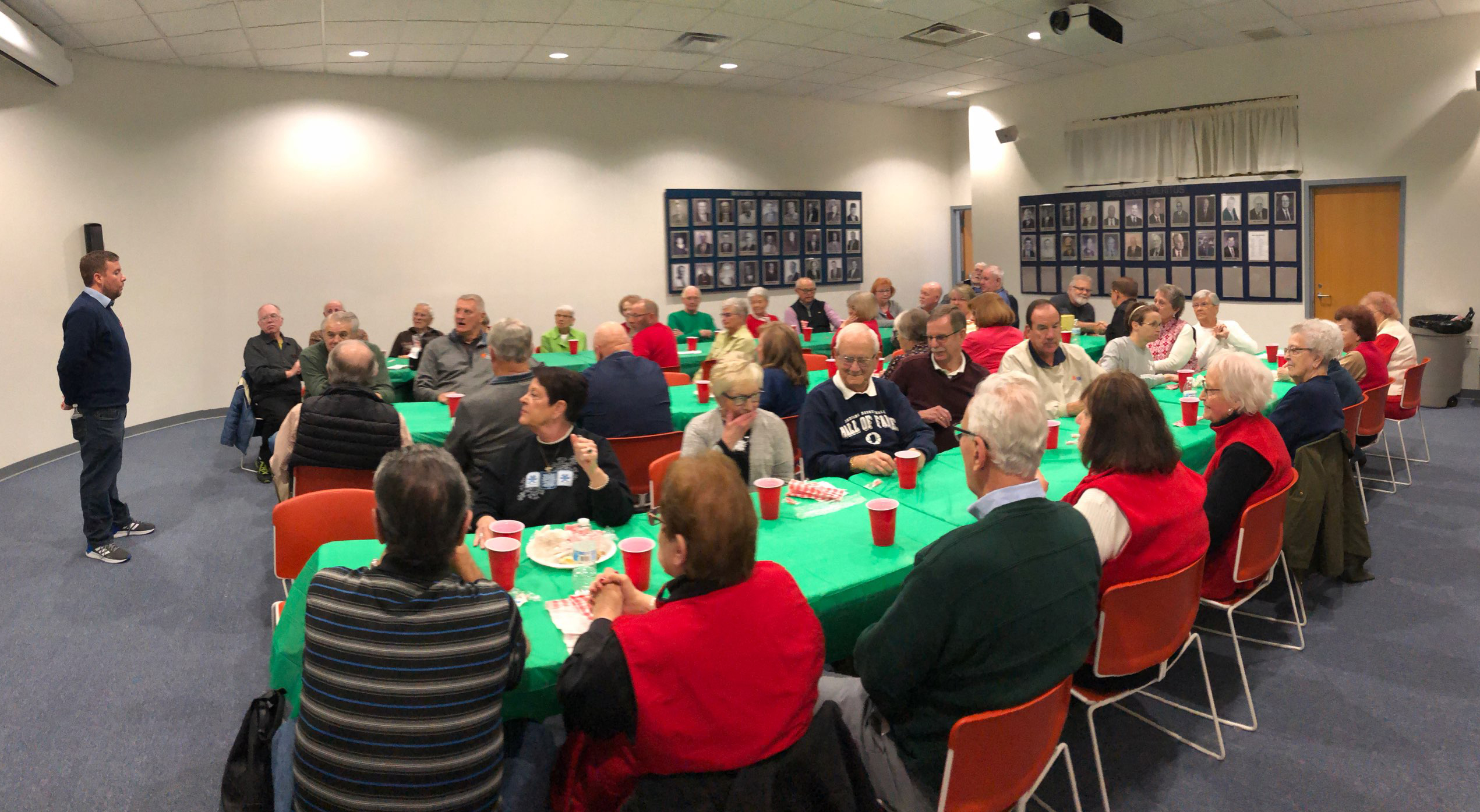 Indiana Basketball Hall of Fame volunteers listen to director Chris May at the Christmas lunch