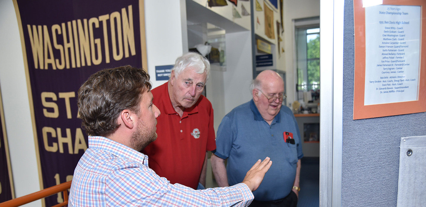 Chris May and volunteer showing Bob Knight the museum at Indiana Basketball Hall of Fame